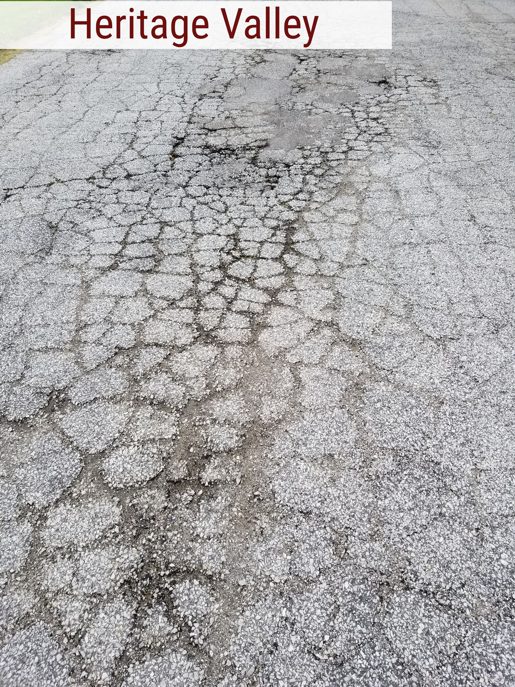 Crumbling road pavement in Heritage Valley subdivision